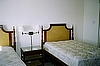Full Bed Complete with Headboard, Bed Frame, Mattress and Box Springs shown with Nighstand and Wrought Iron Double Swing Arm Lamp