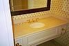 Kohler Bathroom Sink with Brass Faucet and Marble Counter