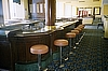 Complete Bar with Cabinetry shown with bar stools
