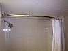 Guestroom Curved Shower Rods and Shower Curtains